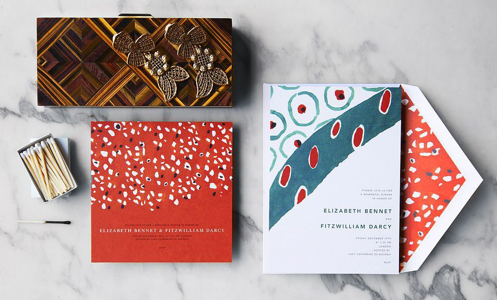 These on-point invitations (prices vary) translate runway prints in a way that's fitting for a Summer soiree. The terracotta red against a deep teal will surely translate well onto a tablescape.