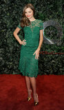 Miranda Kerr's green lace knee-length Burberry dress married a classic fabric with a punchy color, while the gold metallic T-strap pumps pulled in mega dazzle. We can see this ensemble working for an outdoor wedding that maintains a traditional air.