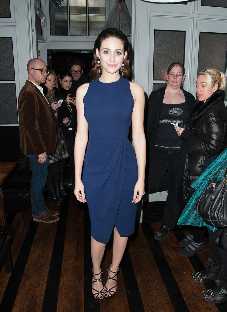 For an evening wedding that's not quite as fancy as black tie, we recommend finding a classic, clean dress, like the sleeveless navy one Emmy Rossum wore in NYC, then bringing it to life via glam touches like colorful drop earrings and strappy sandals.