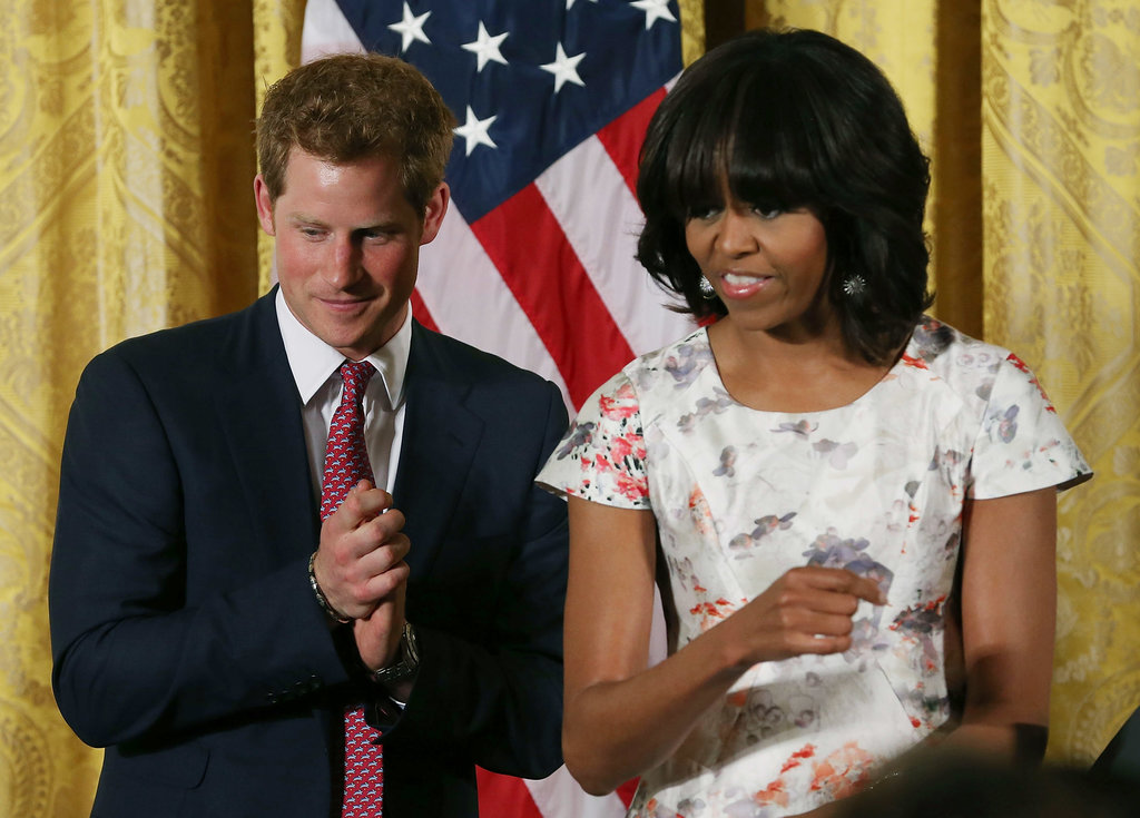 Prince Harry and Michelle Obama took the stage together at an event to honor military families at the White House on Thursday.