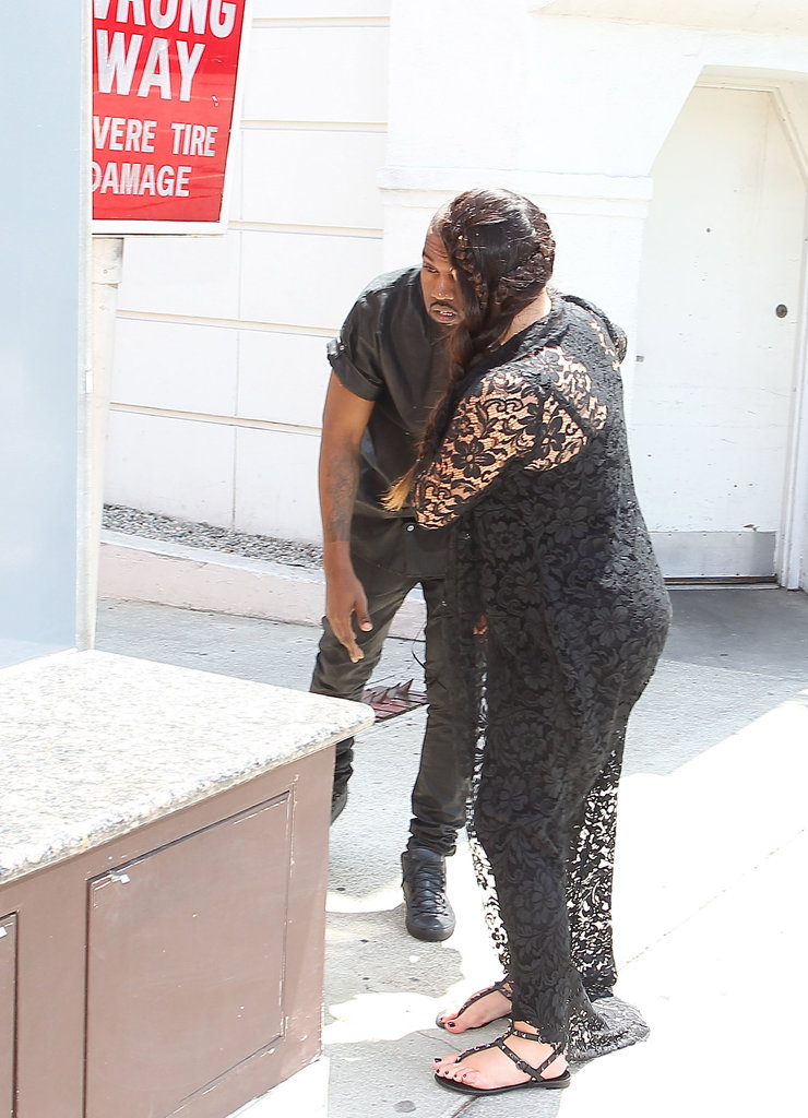 Kim Kardashian held onto her boyfriend, Kanye West, after he hit his head in LA.
