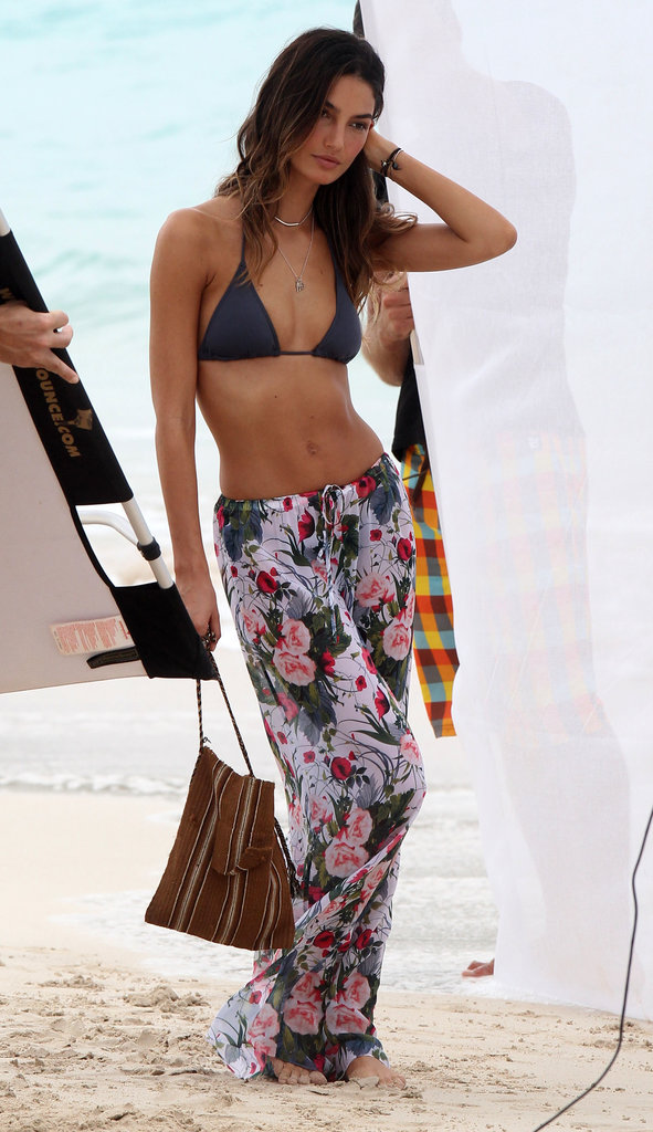 Lily Aldridge held onto a handbag while she modeled a bikini.