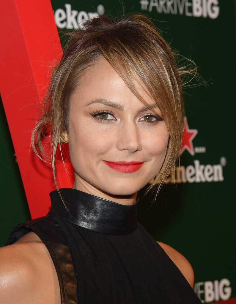 Stacy Keibler dressed up her look with red lips.