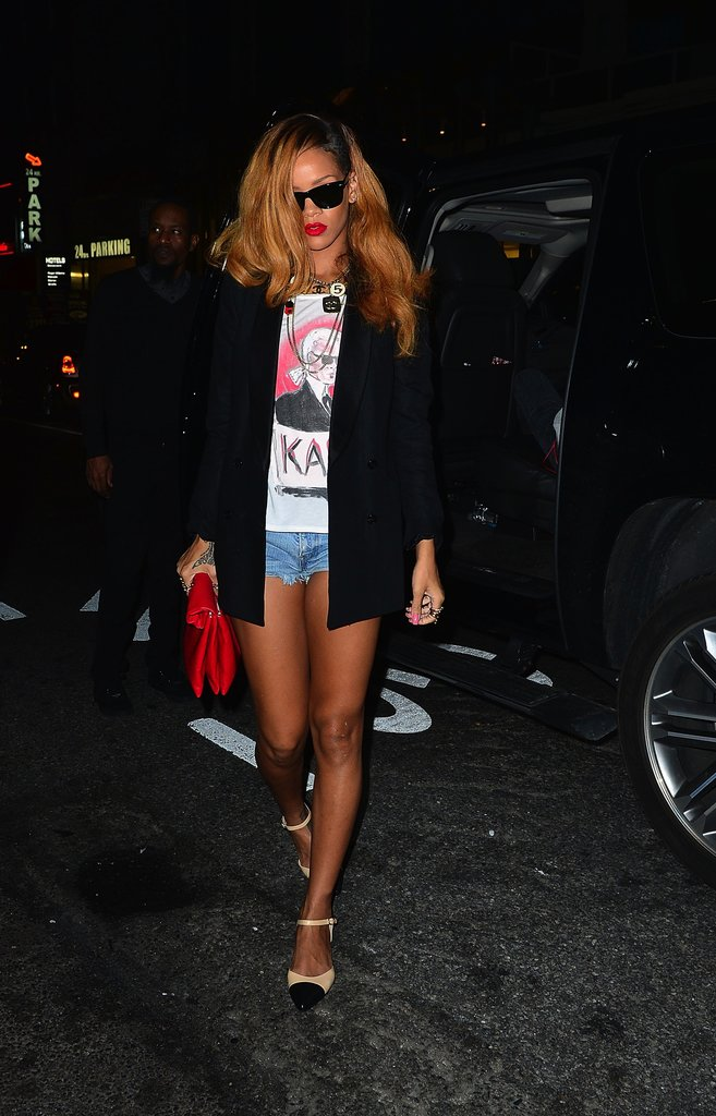 Rihanna took her denim cutoffs out on the town with a Karl Lagerfeld tee, a black blazer, and cap-toe shoes.