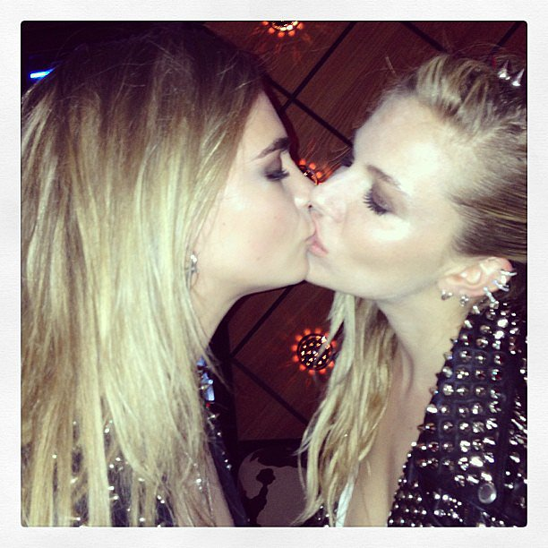 Cara Delevingne locked lips with close friend (and fellow British babe) Sienna Miller at the Met Gala. Source: Instagram user caradelevingne