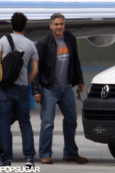George Clooney boarded a plane in Switzerland.