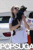 Kristen Bell snuggled her dog Shakey.