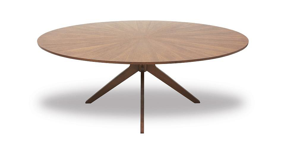 One of our favorite pieces, the Conan Dining Table ($899) recalls Vladimir Kagan's iconic three-pronged tables, as well asCarrie Bradshaw's coffee table in Sex and the City,which set designer Jeremy Conway made by hand. We love how the sunburst-like wood grain mimics the shape of the base.