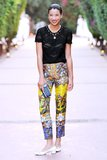 Lily Kwong's brightly patterned pants were a bold wild card with her low-heeled pumps, sheer tee, and studded Diane von Furstenberg clutch. Source: Billy Farrell/BFAnyc.com