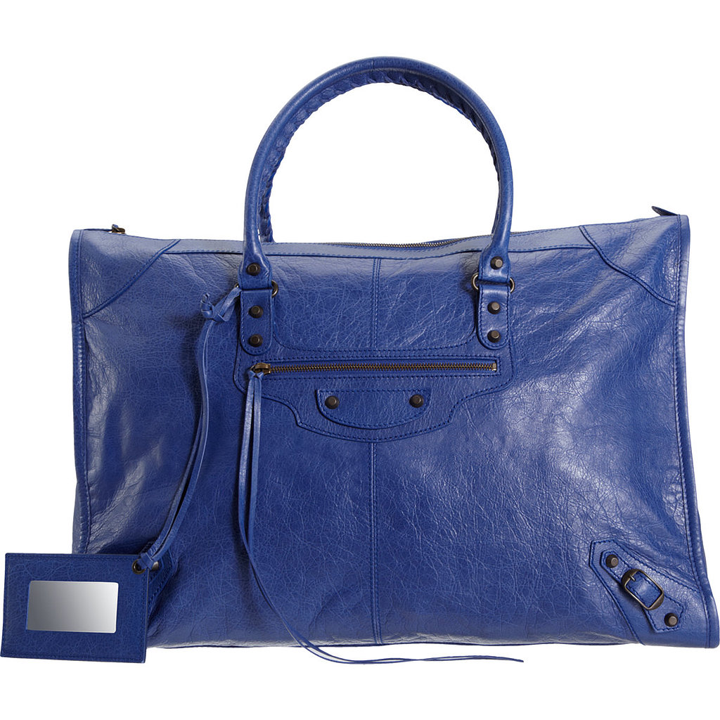 Balenciaga's blue leather weekender bag ($1,845) goes from business trip to weekend reprieve. It's a statement travel bag if we've ever seen one.