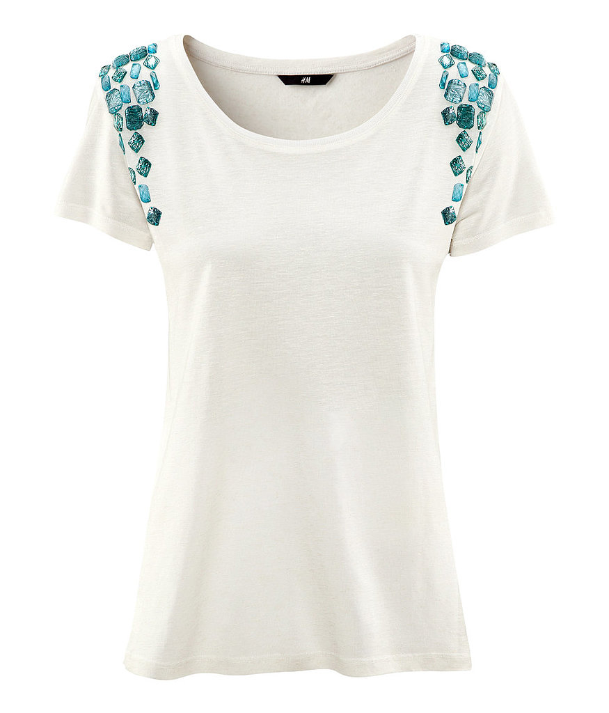 A simple t-shirt with a twist: H&M's Rhinestone-Sleeve Tee ($25) is a great way to dress up a pair of distressed denim.