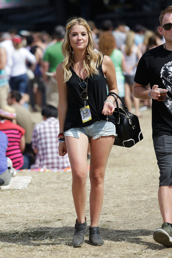 At the BottleRock Festival in Napa, Ashley Benson showed off the quintessential concert look in denim cutoffs and a black tank, both by American Eagle. She topped it off with a black-and-white Alice + Olivia bag.