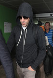 Sacha Baron Cohen rocked a hooded sweatshirt off the plane in Nice, France, on Tuesday.