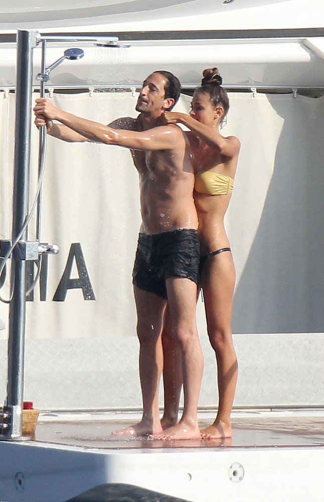 Adrien Brody and Lara Lieto got close while hanging on a yacht in St. Tropez during July 2012.
