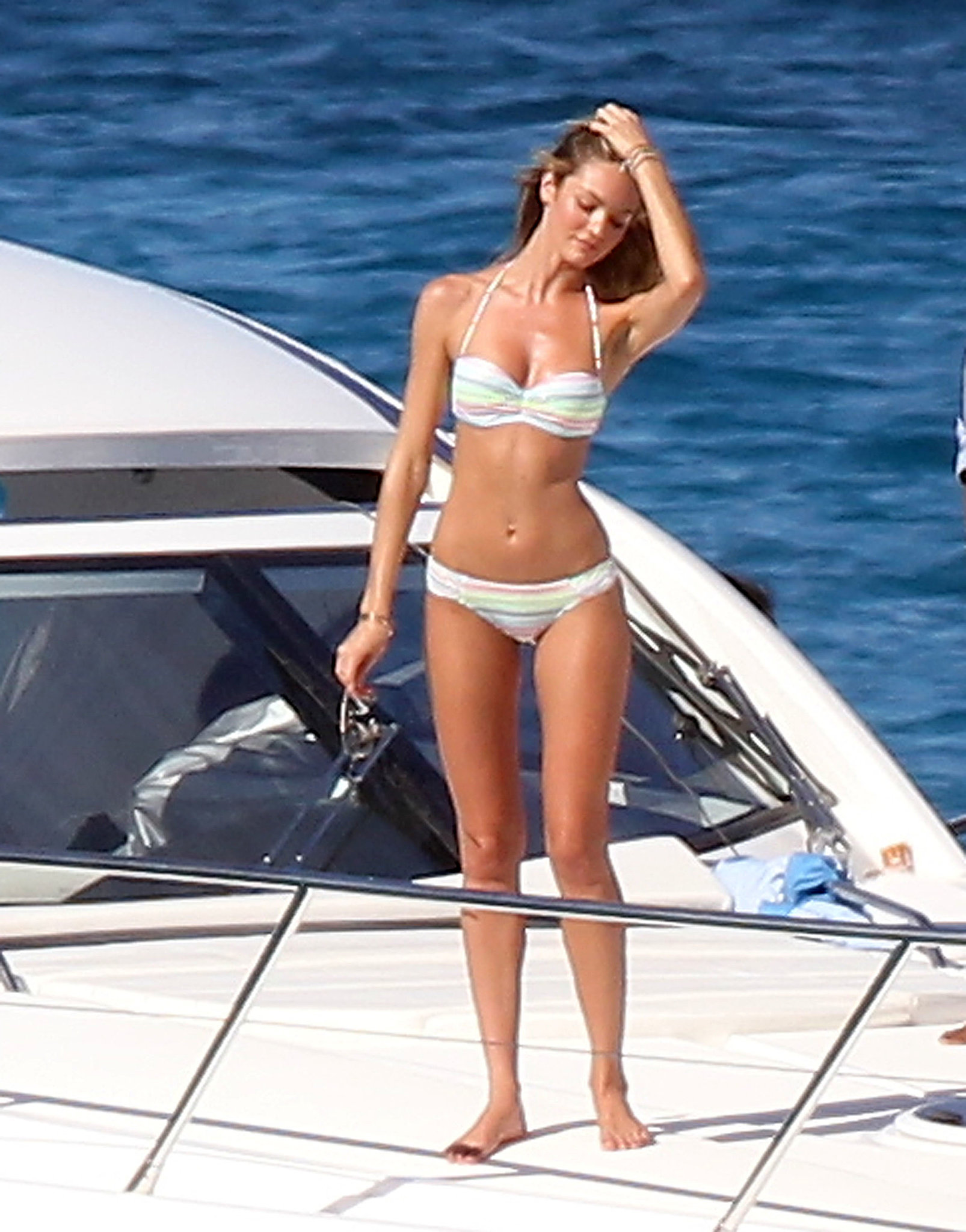 Candice Swanepoel modeled bikinis on a yacht for a Victoria's Secret shoot in St. Barts in January 2013.