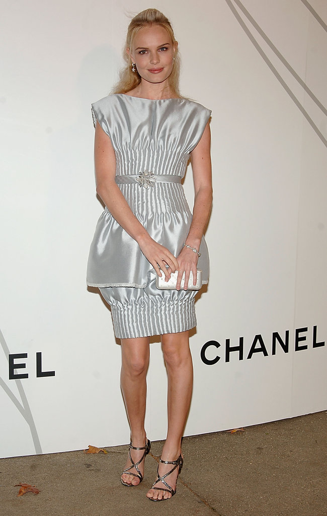 Kate turned heads in a silver ruched Chanel, complete with a bubble skirt and brooch belt, at the Chanel Contemporary Art Container opening in 2008.