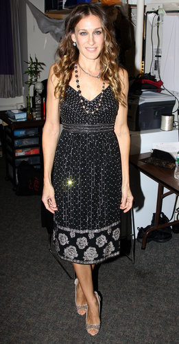 Parker's mixed-print tea dress, crystal-adorned peep-toe pumps, and dual necklaces combined to create the perfect NYC party style for a 2010 Ralph Lauren event.