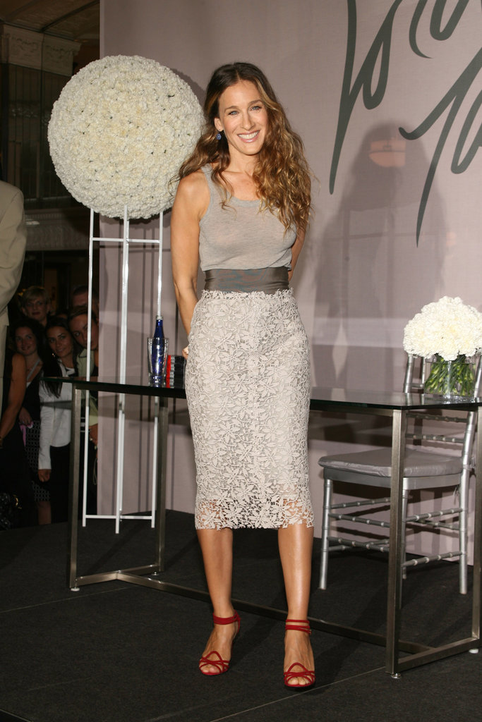 Sarah Jessica Parker's fiery ankle-wrap sandals really popped against her lace-overlay pencil skirt at the NYC unveiling of her Liquid Satin Lovely fragrance.