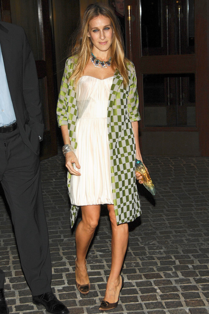 The trendsetter topped her sweet ruched strapless with a lime-green checkerboard coat and multifaceted gemstone necklace at the Flags of Our Fathers screening in New York City.