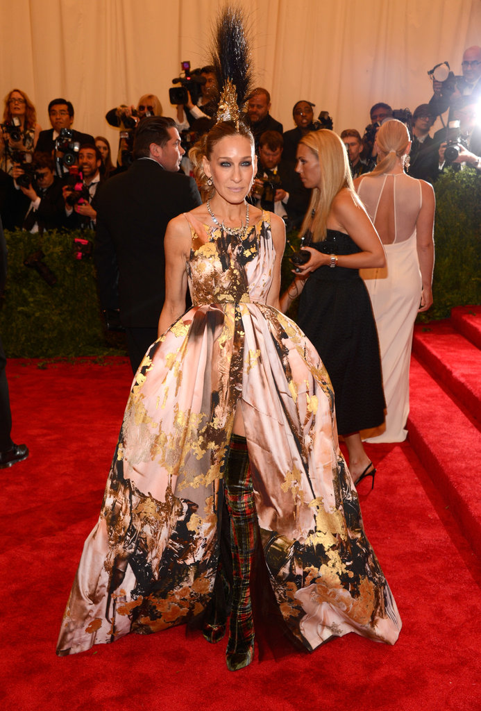Sarah Jessica Parker made an unforgettable entrance at this year's Met Gala, embracing the Punk Chaos theme in a voluminous, gold-leaf Giles creation, Christian Louboutin tartan thigh-high boots, and a showstopping mohawk headpiece by Philip Treacy.