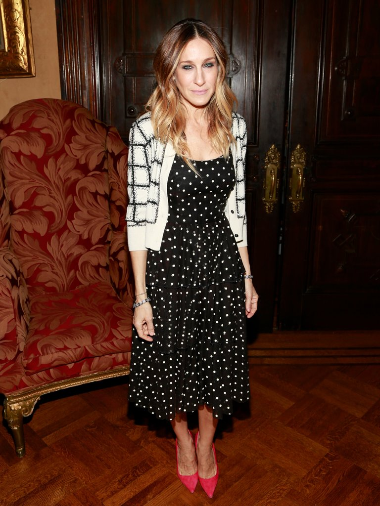 SJP mixed prints like a pro layering a windowpane cardigan over her polka-dot midi dress at the 10th Annual Love 'N' Courage Benefit in February.
