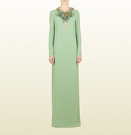 Prepare to turn heads in this pale-jade, retro-modern Gucci gown ($5,500). The neckline has a hand-embroidered floral design with jade stones, turquoise, and light topaz crystals.