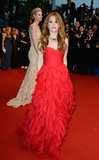 Isla Fisher showed she wasn't afraid of ruffles in her red gown, which she accessorised with a choker statement necklace.
