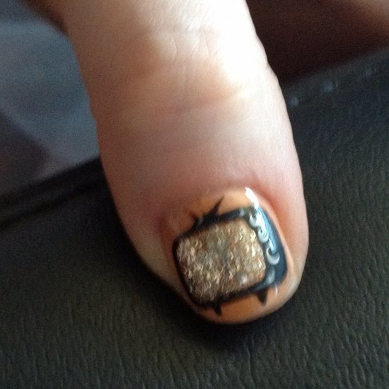 For the 2012 Emmys, Zooey Deschanel wore glittering television sets on her thumbs and sparkling jewels on her other fingers. The complex nail design was created by celebrity manicurist Tom Bachik.  Source: Instagram user ZooeyDeschanel