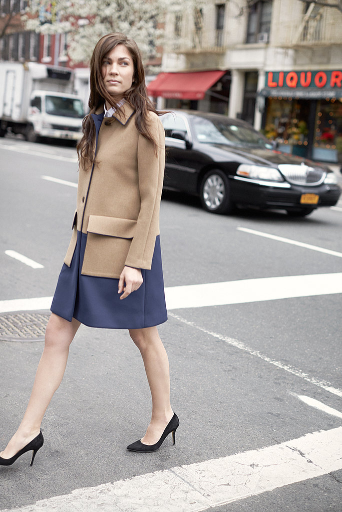 We could envision Kate Middleton wearing this elegant combo of a colorblocked car coat and black pumps.