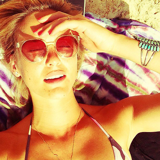 Bar Refaeli lounged in the sun and shaded her face with a very cool pair of retro sunnies. Source: Instagam user barrefaeli