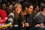 Jessica Alba and Cash Warren laughed courtside at an LA Laker home game in December 2007.