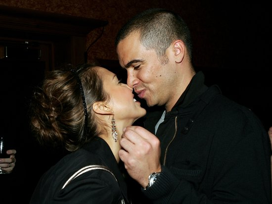 Jessica Alba and Cash Warren nuzzled in Detroit at a Super Bowl event in February 2006.