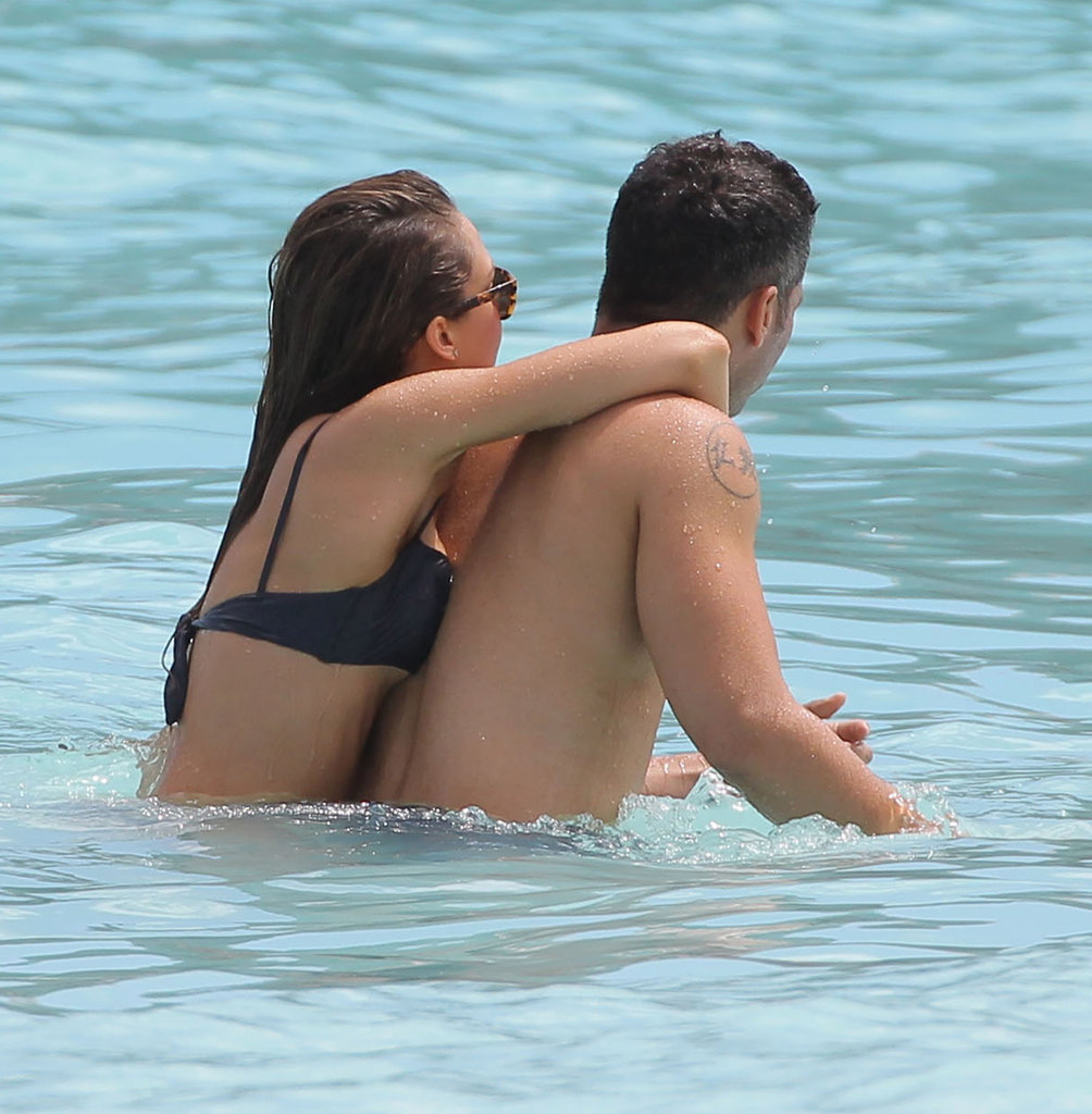 Jessica Alba and Cash Warren cuddled in the water while in St. Barts in April 2013.