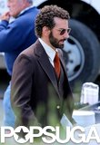 Bradley Cooper kept his perm up while on the Boston set of American Hustle on Wednesday.