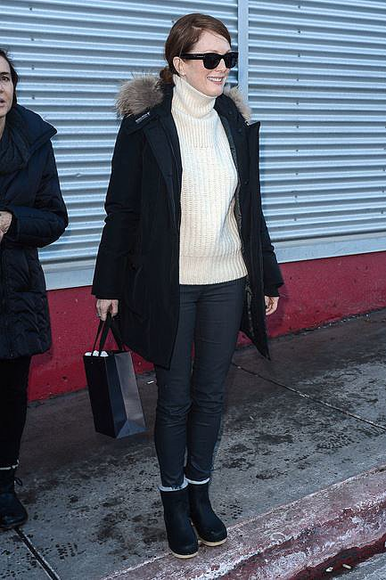 A cream turtleneck is a classic way to keep cosy. Julianne Moore teamed hers with a fur-edged pea coat and schmick sunnies.