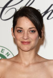 Marion Cotillard attended the Chopard luncheon in Cannes, donning a casual updo and barely there makeup.