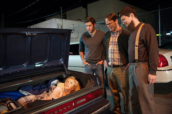 Here's something you don't see at every bachelor party: the bride-to-be in the trunk of a car.