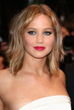 Jennifer Lawrence remixed her beauty look for the Jimmy P. (Psychotherapy of a Plains Indian) red carpet by swiping on a bright fuchsia lipstick.