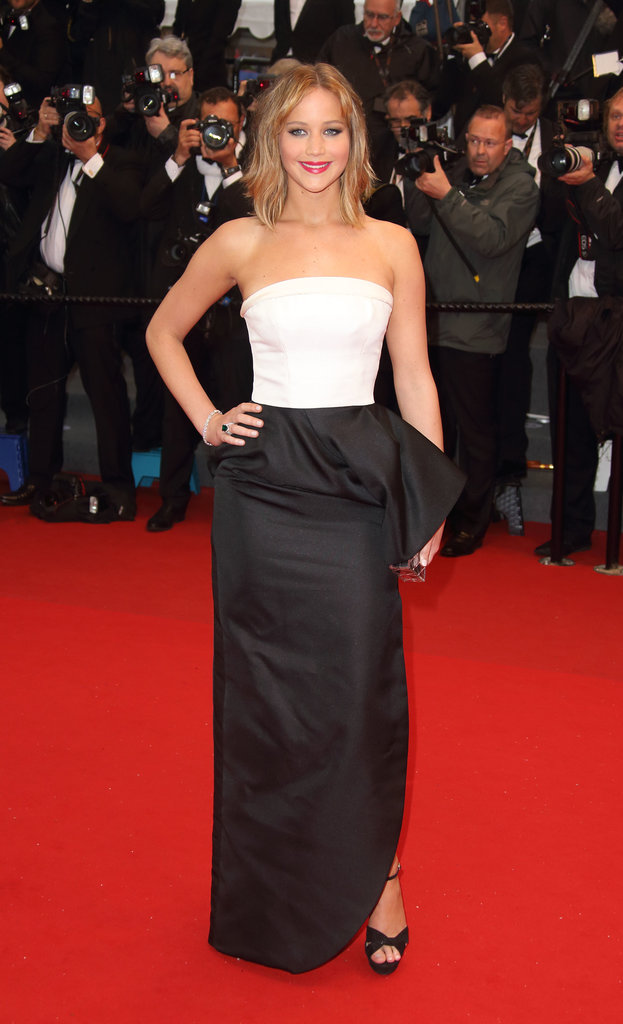 Jennifer Lawrence made an elegant arrival in a white-and-black Dior gown, Charlotte Olympia clutch, and Chopard jewels at the Jimmy P.: Psychotherapy of a Plains Indian premiere.