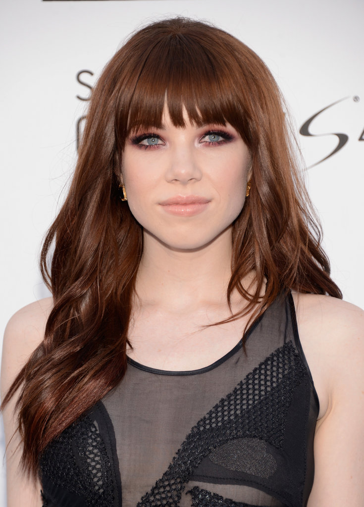 Carly Rae Jepsen complemented her new red hair with a pinkish-red smoky eye and glossy nude lips.