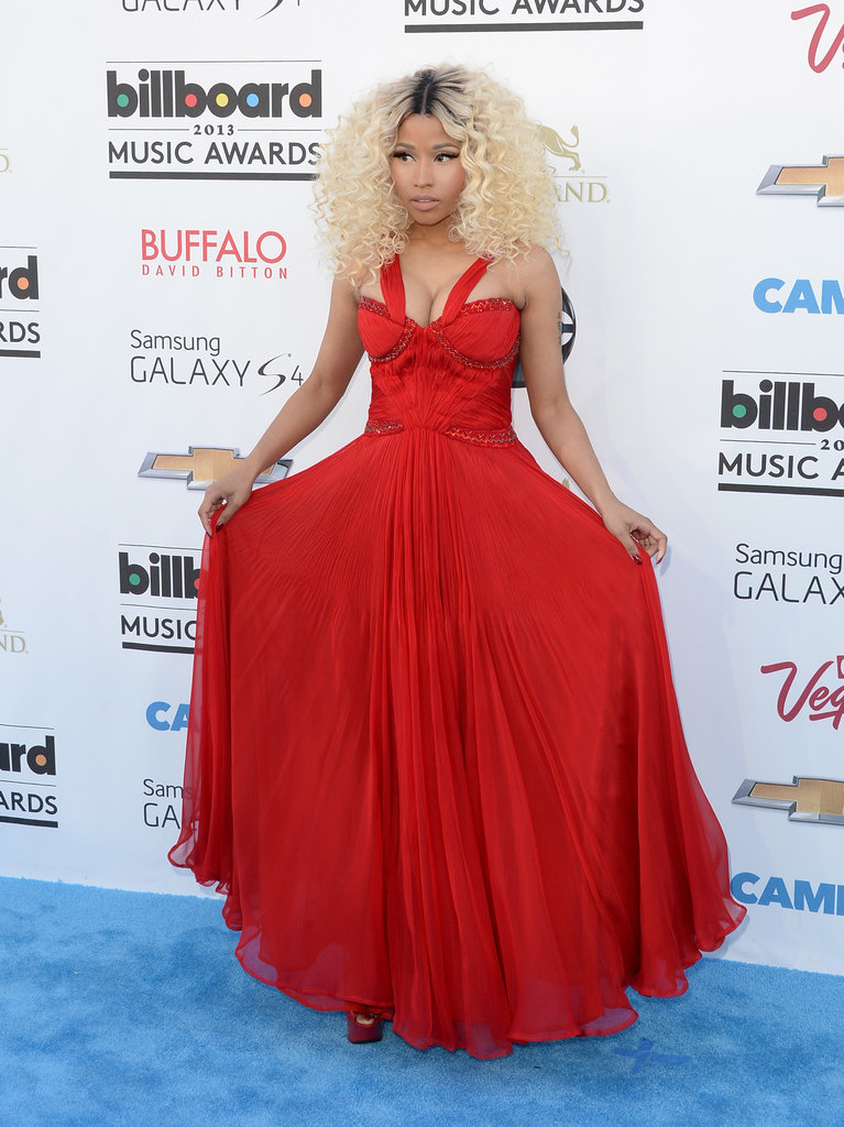 Nicki Minaj brought the color in a bright red gown with sequins along the bodice and matching platform sandals.