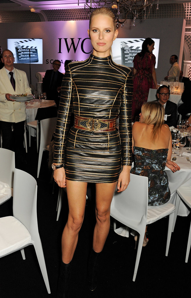 Karolina Kurkova put her long legs on display in a black-and-gold striped long-sleeved Balmain minidress at the For the Love of Cinema party.