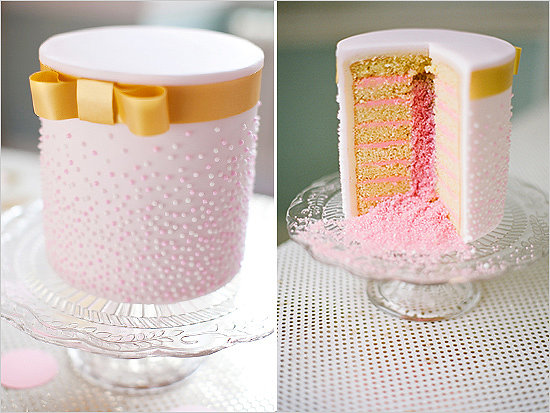 It's not just the outside of this cake that stands out for being dainty with its gold bow and pink dots — just look at the layers of yumminess inside.  Photo by Segerius Bruce Photography via Wedding Chicks