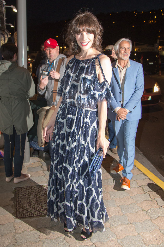 Milla Jovovich arrived in a breezy printed gown and Swarovski jewelry for the Vanity Fair and Chanel dinner.