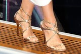 Cindy Crawford wore a pair of strappy metallic sandals.