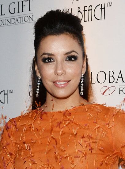 At Eva Longoria's Global Gift Gala afterparty in Cannes, the actress was decked out in orange with a half updo and smoky eyes.