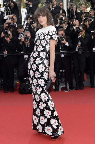 Milla Jovovich arrived to the premiere of Blood Ties in a floor-length black, white, and red floral Chanel gown that never stopped shimmering, thanks to elaborate sequined embellishment.