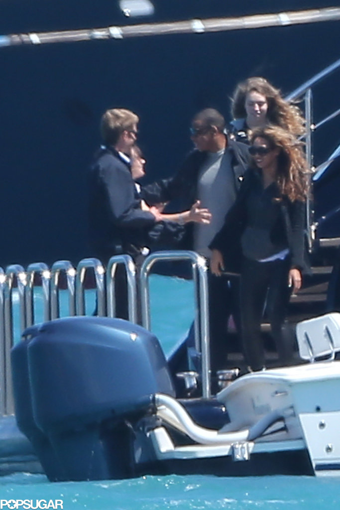 Jay-Z and Beyoncé Knowles were escorted to a waiting boat.