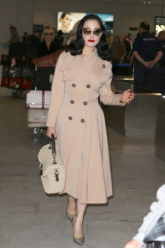 Dita Von Teese put her trench coat to good use at the airport. We imagine she's wearing something equally fabulous underneath, but you know, if not, we'd never be able to tell. Just finish the look with polished accessories and a bold red lip for a luxe travel style you might have sworn you saw on Mad Men.