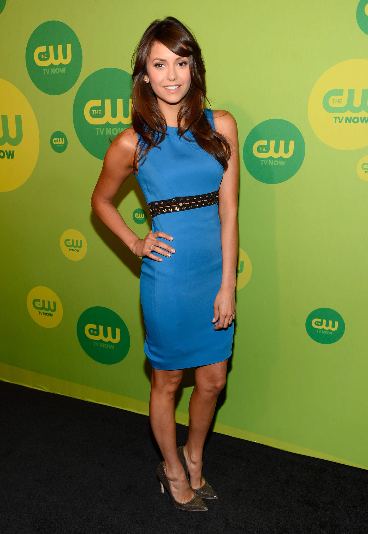 Nina Dobrev's sleeveless blue Versace minidress featured an edgy slit and studs that took it to a new level. She gave her look a classic finish with metallic pumps.